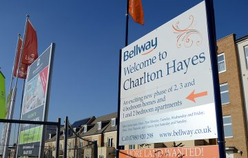 Photo of house builders' advertising signs at Charlton Hayes.