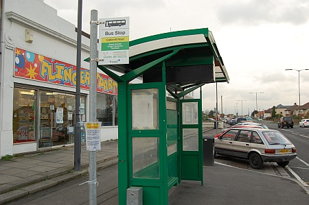 Bus stop outside the Flingers party shop in Patchway, Bristol