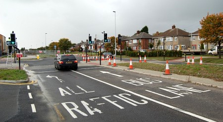 A car ignores the new 'bus only' restrictions on Highwood Road, Patchway.