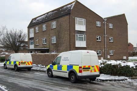 Police crime scene investigation vehicles outside a property in Willow Close.