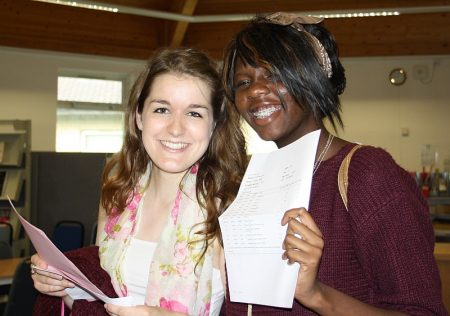 PCC students Abigail Edwards and Zainab Bello examine their A-level results.