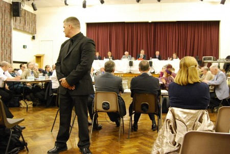 A security guard keeps watch at the Highwood Road council meeting.