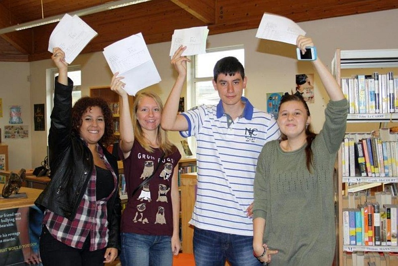 Students at Patchway Community College celebrate their A-level results.