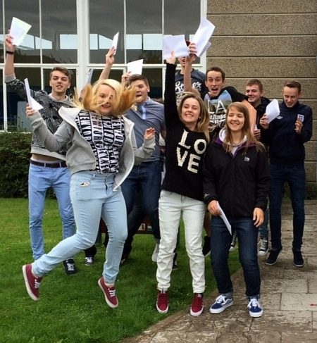 Students at Patchway Community College celebrate their GCSE results.