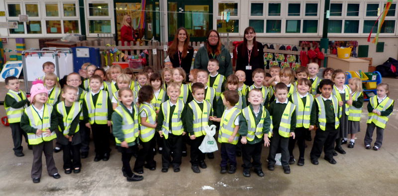 Pupils at Callicroft Primary School, Patchway wearing high visibility vests donated by Specsavers.