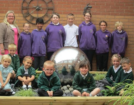 Callicroft Primary School pupils celebrate a 'good' Ofsted report.