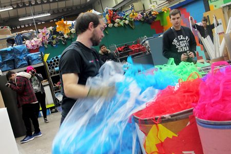 Scrap ripstock from balloon production enters the Children's Scrapstore warehouse.