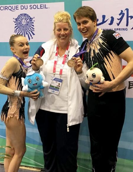 Acrogymnastics world championship bronze medalist winners Kenedi Cross (left) and Vada Finniear (right), with coach Sarah Bateman.
