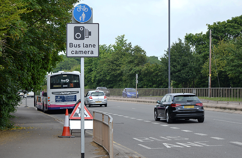 Bus lane enforcement camera sign on the Gloucester Road (A38) northbound approach to the Aztec West Roundabout.