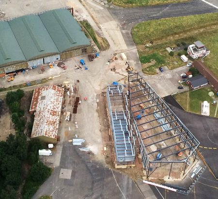 An aerial shot of Aerospace Bristol. This photo shows WWI grade II listed hangar 16S in the top left and the steelwork of the new Concorde hangar under construction.