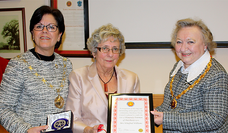 Conferring of the title of Honorary Freeman of Patchway on Win Williams. L-r: Cllr Erica Williams (chair of South Gloucestershire Council), Win Williams and Cllr Eve Orpen (chair of Patchway Town Council).