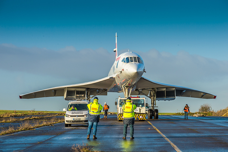 Photo of Concorde 216 being moved across the runway at Filton.