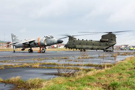 Photo of an RAF Chinook alongside a Sea Harrier 'jump jet'.