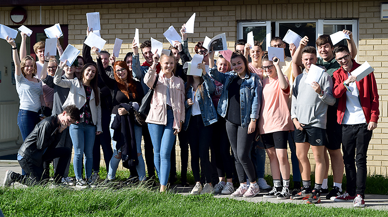 Photo of post-16 students celebrating their examination results.