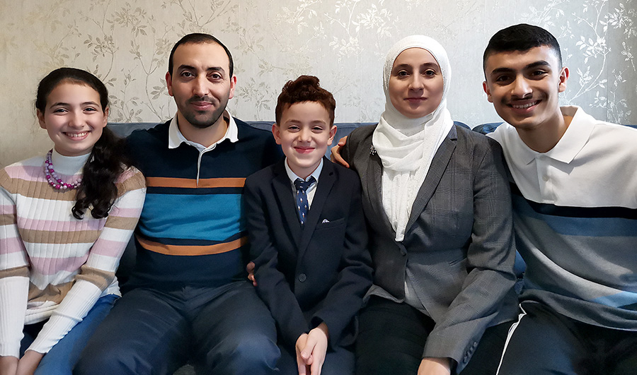 Photo of Syrian refugee Hisham Alsaiyad and family.